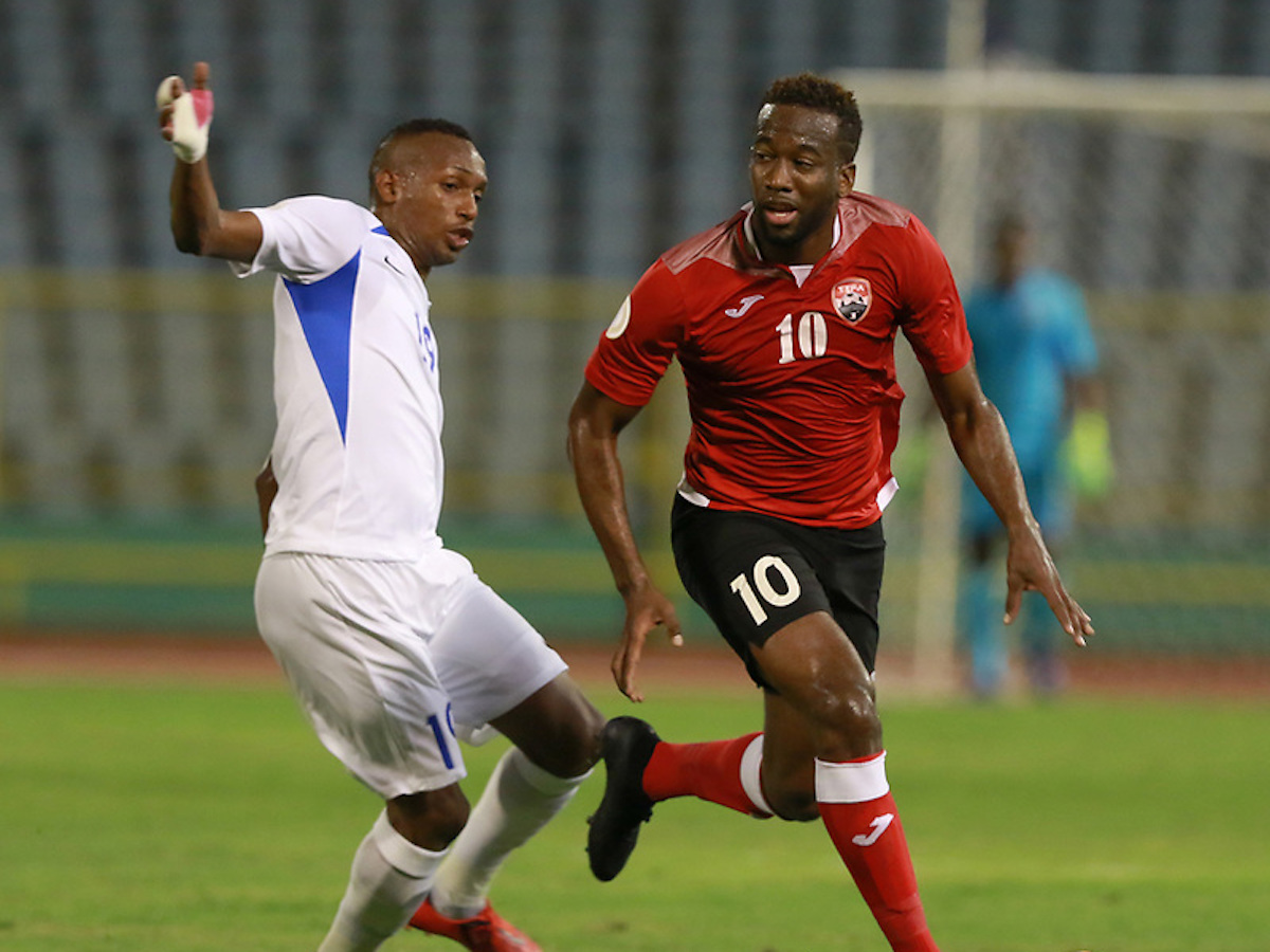 2019.09.10: Kevin Molino,right,tries to escape a Martinique player during the Concacaf Nations League match between Trinidad & Tobago and Martinique at the Hasely Crawford Stadium,Port of Spain.Image:Nicholas Bhajan/CA-images