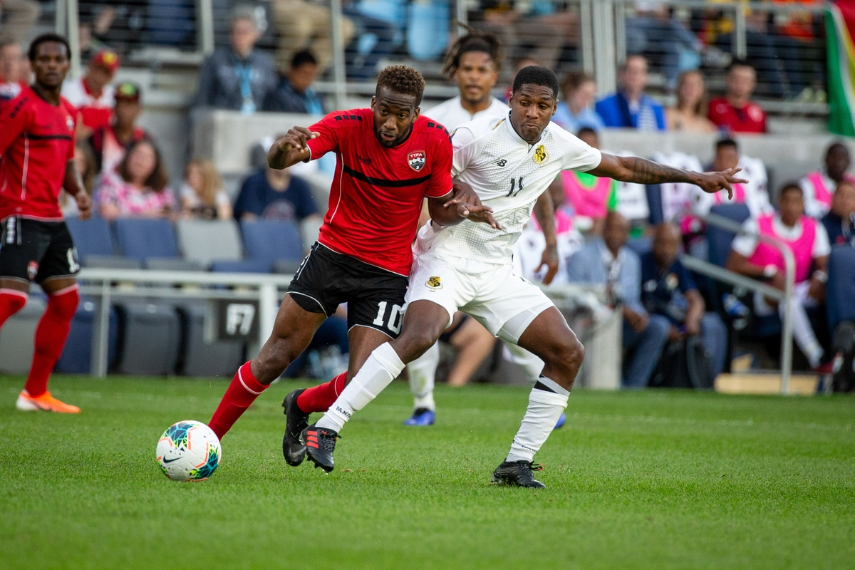 Jun 18, 2019; Saint Paul, MN, USA; Panama midfielder Armando Cooper (11) trips Trinidad and Tobago midfielder Kevin Molino (10) during group play in the CONCACAF Gold Cup soccer tournament at Allianz Field. PHOTO: Bruce Kluckhohn-USA TODAY Sports