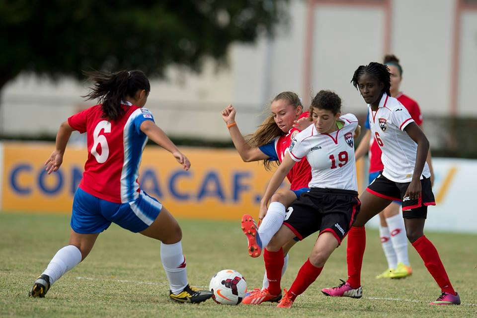 Trinidad & Tobago captain Anique Walker (#19) tries to hold off Costa Rica's Gloriana Villalobos in the third place match at the 2014 CONCACAF Women's Under-20 Championship.