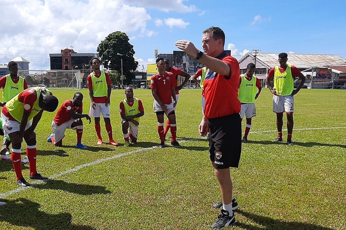 National senior team men's head coach Terry Fenwick gives instructions to his players as the team resumed training last month at the the St James Barracks.
