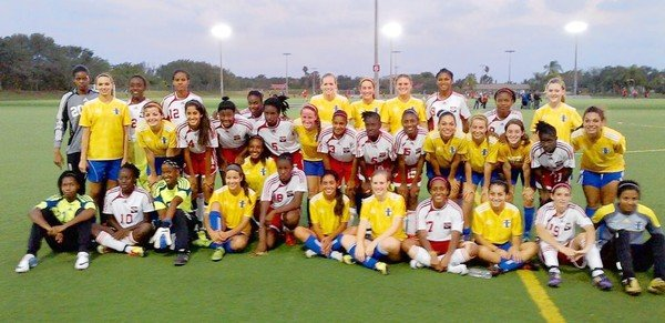 FAN FRIENDLY The Plantation Eagles girls' soccer program recently hosted the Under-17 Division women's national team from Trinidad. (submitted photo / May 23, 2012) .