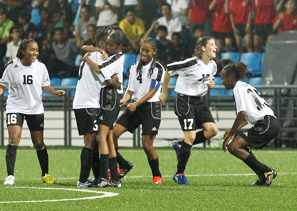 Trinidad & Tobago players celebrate at the end of the penalty shoot-out during the Papua New Guinea versus Trinidad & Tobago 5th-6th ranking match of the Singapore 2010 Youth Olympic Games (YOG) played at the Jalan Besar Stadium in Singapore, Aug 23, 2010. Trinidad & Tobago won 4-2 on penalty shoot-out. Photo: SPH-SYOGOC/Seyu Tzyy Wei