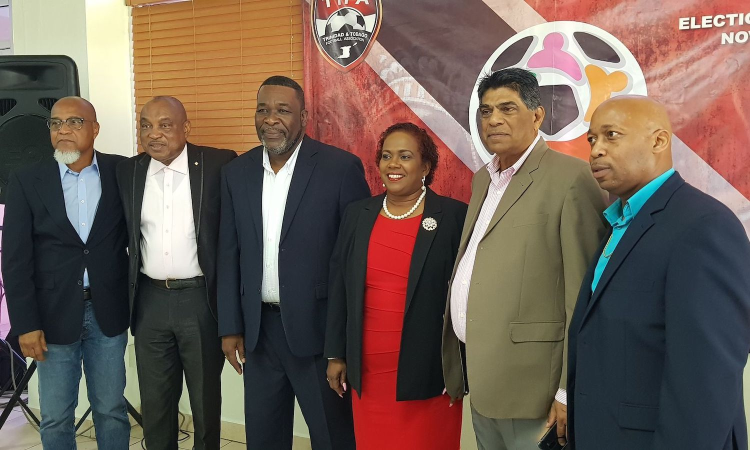 United TTFA president William Wallace, third from left, is flanked by Keith Look Loy, left- TTSL Board member, Joseph Sam Phillip- vice president, Clynt Taylor- his first vice president at right, Anthony Harford- president of the NFA, second from right, Susan Joseph-Warrick, second vice president, at November 2019 Breakfast Launch for their slate.