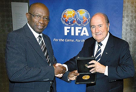 Warner and Blatter in better times.