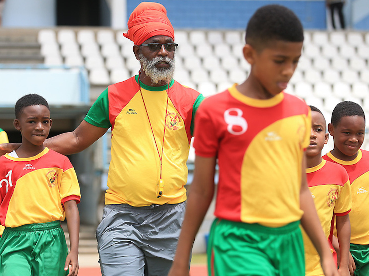 "Coach Anthony ""Dada"" Wickham with his Trendsetter Hawks Boys U-11 team as they face QPCC FC at the Semifinals of the Republic Bank Youth League at the Larry Gomes Stadium, Arima on June 29th, 2019. PHOTO: Allan V. Crane"