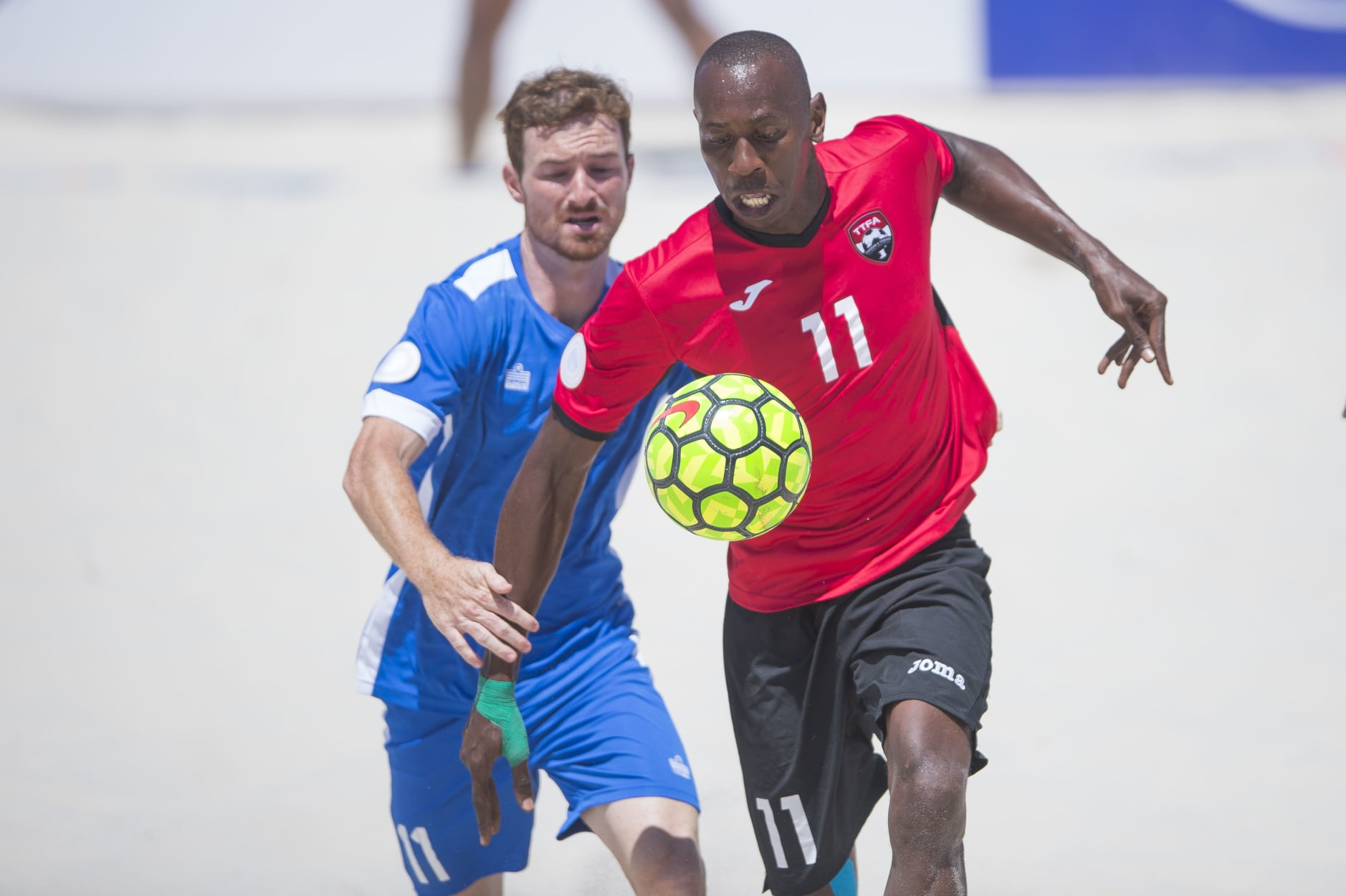 Woodley's hat-trick sends T&T to quarters.
