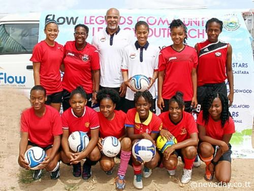 England's Rachel Yankey, back centre, poses with George Berry of the Professional Footballers Association and members of the St Augustine Secondary School. Photo: Sureash Cholai