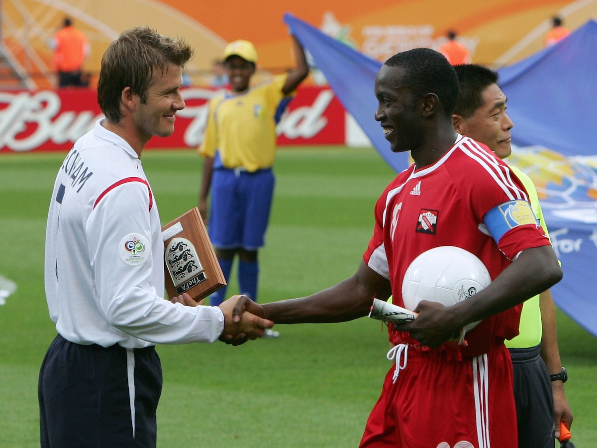 Nurnberg, GERMANY: English midfielder David Beckham (L) shakes hands with Trinidad and Tobago's forward Dwight Yorke (R) before their opening round Group B World Cup football match at Nuremberg's Franken Stadium, 15 June 2006. England won the match 2-0. AFP PHOTO / ADRIAN DENNIS (Photo credit should read ADRIAN DENNIS/AFP via Getty Images)