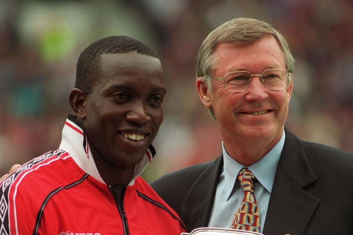 Manchester United manager Alex Ferguson (right) presents Dwight Yorke (left) with the club's Player of the Year award (Photo by Neal Simpson/EMPICS via Getty Images)